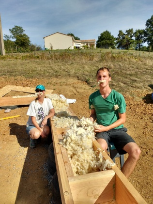 Baaaa! Filling the beam with natural sheep's wool...and messing around! Such a soft material after all the others we had been using.