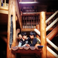 The boys reading to each other from their extensive library on the magnificent staircase