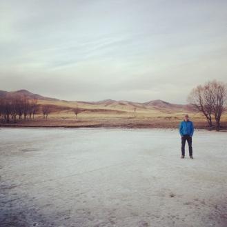 A deeply frozen river cuts through the endless landscape