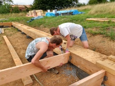 Fixing the joists into place.