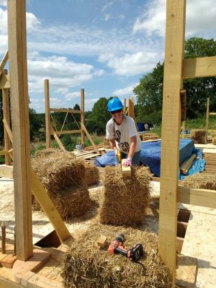 Once the bracings were up it was time for the bales!! Notching them to fit snuggly around the window posts.