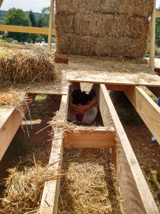 It was seriously hot whilst placing the bales. Our heaven-sent angel, Jo, catching some cool time under the house.