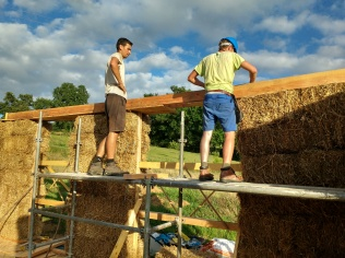 Placing the roof beam.