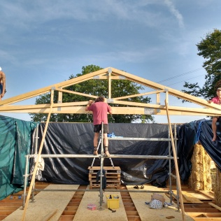 The first of 25 trusses to go up.