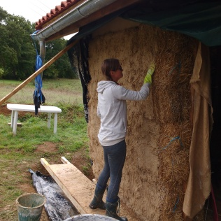 Getting to grips with massaging the render into the straw.