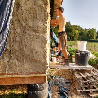 A sunny day on the front of the house, it was an ongoing battle to keep the lime render moist enough.