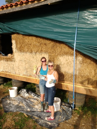 Applying the key coat to the front side with Dan's sister Claire. It was super hot for October