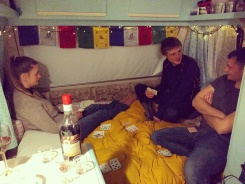 Making the most of our inside space on cold winter nights by playing cards and drinking Pineau.