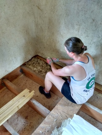 Teasing the wool to fill the joists